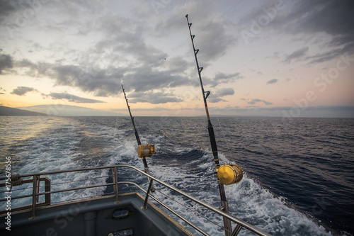 Deep Sea Fishing Reel on a boat during sunrise Poster