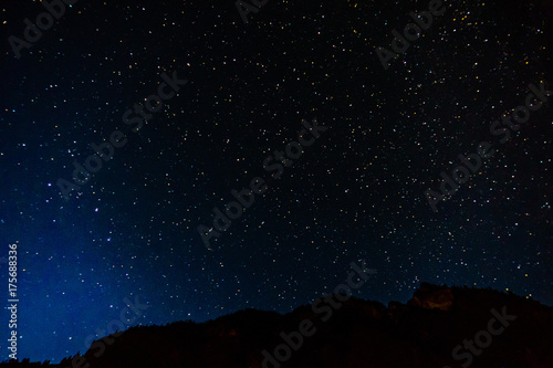 Many starts on blue dark night sky as a cosmos background.