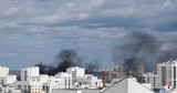 Black smoke from a fire over residential multi-storey buildings - 175688700