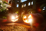 Evil grins of jack-o-lanterns burning on halloween night - 175688712
