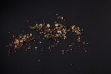 Spices scattered on a black background - 175700353