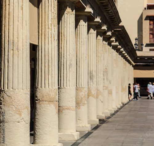 Foto op Canvas Barcelona People Beyond Spanish Columns