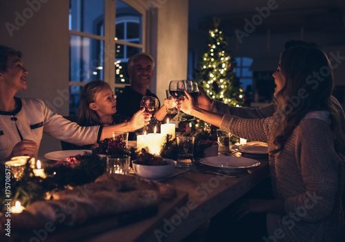 Happy family celebrating christmas together at home