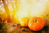 Pumpkins and autumn leaves on wooden table. thanksgiving and halloween concept - 175716536