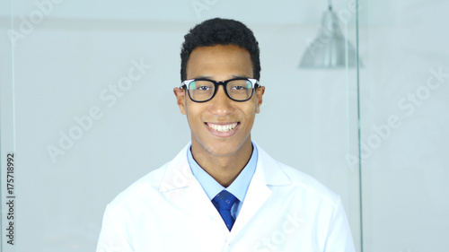 Portrait of Smiling Doctor Looking At Camera, Satisfied