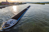 Cargo ship with coal bulk load on the river Rhine in Mainz, Germany - 175721570