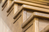 Detail close-up image of wooden oak stairs in house interior - 175721763