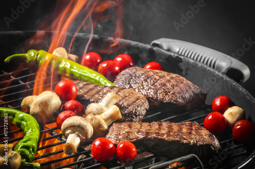 Delicious cooked meat with vegetables on grill