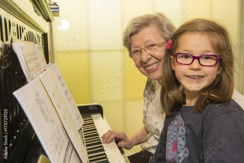 canvas print picture Grandma and Kid Playing the Piano
