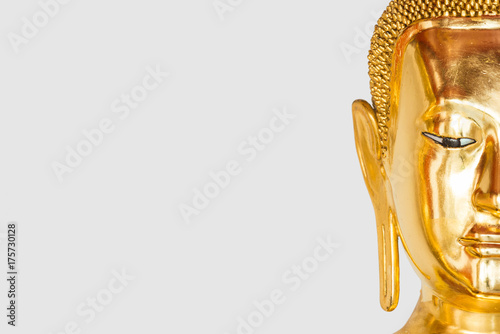 Foto Spatwand Boeddha Isolated half face of buddha on a white background