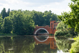 Arch of the old bridge over the pond in the Manor of Marfino, Russia. - 175738550
