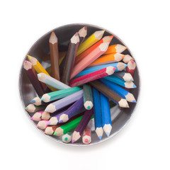 Colored pencils on white table