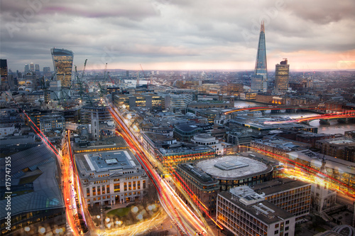 City of London at sunset and traffic blur lights on busy roads Poster