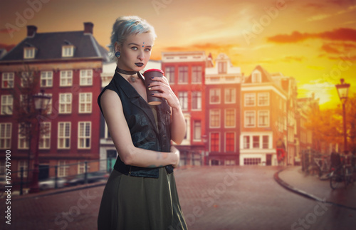 girl with blue hair drinks coffee on a street in Amsterdam Poster