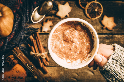 Autumn pumpkin spice latte on rustic wood background