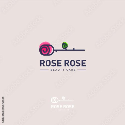 Rose logo. Rose emblem. The flower on a light - pink background and letters. - 175755534