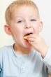 Little boy eating apple for snack