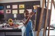 Confident girl painting on canvas - 175759397