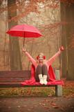 Girl in autumn park enjoying hot drink - 175761389