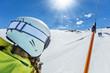 Quadro Happy young woman skier on ski drag lift.