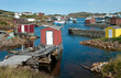 Newfoundland Fishing Village:  Fishing shanties sit on rustic wooden piers and rock jetties that extend into a small harbor on the north coast of Newfoundland.