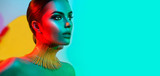 Fashion model woman in colorful bright lights posing. Portrait of beautiful sexy girl with trendy makeup - 175773511