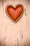 One wooden heart on rustic wood background. Valentines days concept.  Love symbol. Greeting card with copy space. - 175773907