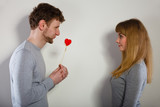 Man giving heart to his girl. - 175784786