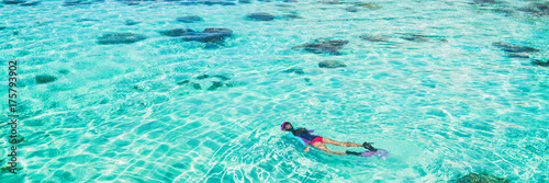 Vacation tourist snorkel woman swimming snorkeling in paradise clear water banner panorama. Swim girl snorkeler in crystalline waters and coral reefs. Turquoise ocean background.