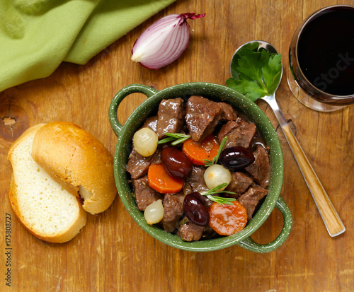 Wall mural beef stew in red wine with vegetables and herbs