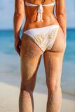 Back of young woman in bikini standing on the beach - 175819116