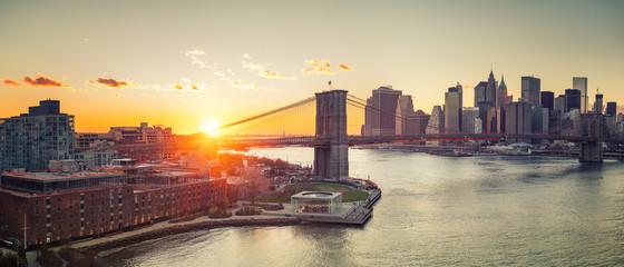 Panoramic view of Brooklyn bridge and Manhattan at sunset, New York City