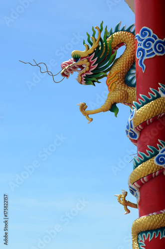 Deurstickers Peking Chinese dragon in front of blue sky.