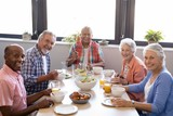 Portrait of senior people having breakfast at table - 175822989
