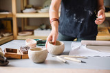 pottery craftsmanship potter craftsman hands working red clay - 175825124