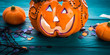 Halloween trick or treat still life on dark green. Toy pumpkin, sweets, marshmalllow, confetti. Holiday mood background banner