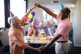 Senior couple making frame against friends at birthday party - 175826711