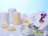 Lit candles and orchid - 175832704