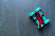 two green dumbbell with red gift bow on a black table background, sport and healthy concep