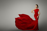 Fashion Model in Red Beauty Dress, Sexy Woman posing evening Gown, Flying Silk Tail over gray background - 175834546