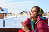 Happy Winter Woman With Headphones - Beautiful girl listening to music outside - 175845905