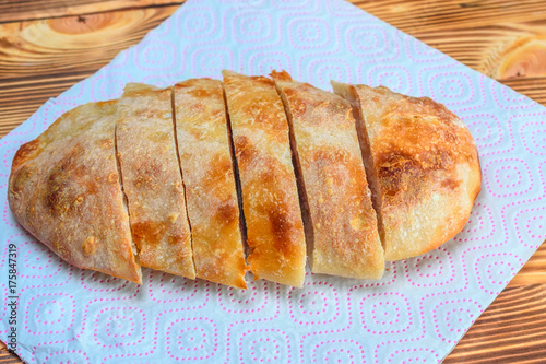 sliced homemade bread on a wooden background