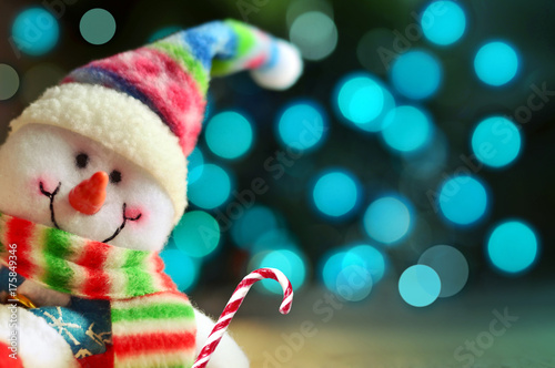 Funny snowman with lights in the background. Happy new year Poster