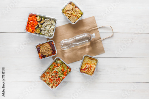 Healthy food take away in boxes, top view at wood - 175851511