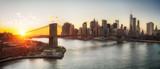 Panoramic view of Brooklyn bridge and Manhattan at sunset, New York City - 175854588