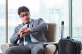 Young businessman in airport business lounge waiting for flight - 175856387