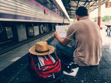 Traveler sitting and looking at the map in train station. Travel concept - 175856715