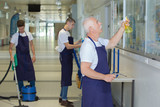 team of men cleaning the office as a job - 175869766