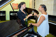 Women by piano toasting with champagne