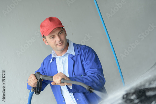 Poster cleaning car using high pressure water